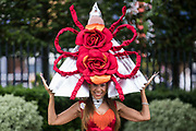 Racegoer Tracy Rose arrives at Royal Ascot for Ladies Day wearing a hat featuring two large red roses on 17th June 2021 in Ascot, United Kingdom. Despite Covid restrictions and changeable weather including some rain, many racegoers displayed the elaborate hats and fascinators for which Gold Cup Day has become well known.