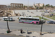 Local traffic in the main square opposite the ancient Egyptian Luxor Temple, Nile Valley, Egypt, seen from a first storey cafe.