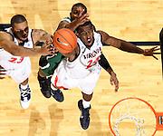 Nov. 15, 2010; Charlottesville, VA, USA; Virginia Cavaliers guard K.T. Harrell (24) reaches for the rebound with Virginia Cavaliers forward Mike Scott (23) and USC Upstate Spartans forward Torrey Craig (23) during the game at the John Paul Jones Arena. Virginia won 74-54. Photo