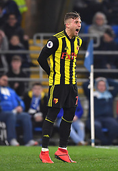 Watford's Gerard Deulofeu celebrates scoring his side's third goal of the game during the Premier League match at the Cardiff City Stadium.