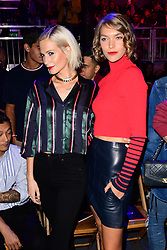 Poppy Delevingne and Arizona Muse during the Tommy Hilfiger Front row during London Fashion Week SS18 held at Roundhouse, Chalk Farm Rd, London. Picture Date: Tuesday 19 September. Photo credit should read: Ian West/PA Wire