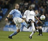 Photo Aidan Ellis, Digitalsport<br /> Manchester City v Bolton Wanderers.<br /> FA Barclays Premiership.<br /> 07/03/2005.<br /> City's Paul Bosvelt and Bolton's Jay-Jay Okocha stretch for the ball