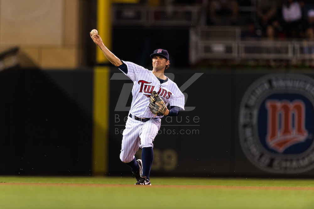 Brian Dozier (20) of the Minnesota Twins makes a throw to 1st base during a game against the Tampa Bay Rays on August 10, 2012 at Target Field in Minneapolis, Minnesota.  The Rays defeated the Twins 12 to 6.  Photo: Ben Krause