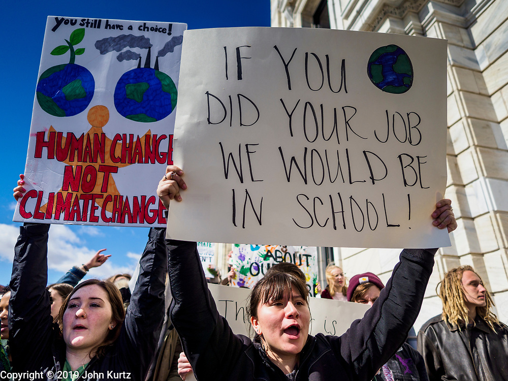 """15 MARCH 2019 - ST. PAUL, MINNESOTA, USA: Students chant during the MN Youth for Climate Justice """"Climate Strike"""" at the Minnesota State Capitol in St. Paul, MN. Thousands of high school students braved below freezing temperatures and biting winds to demand action on climate change. The Minnesota Climate Strike was inspired by the strike by Greta Thunberg, a Swedish high school student, who started a climate strike at her school in August 2018.       PHOTO BY JACK KURTZ"""