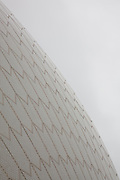 """The roof is constructed of a series of precast concrete """"shells"""". The roofs of the Sydney Opera House are covered in a subtle chevron pattern with 1,056,006 glossy white- and matte-cream-colored Swedish-made glazed ceramic  tiles from Höganäs AB though, from a distance, the shells appear a uniform white...Architect: Jørn Utzon. Structural engineer: Ove Arup & Partners. Completed: 1973. UNESCO World Heritage Site 2007"""