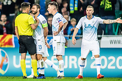 Referee Xavier Estrada Fernandez arguing  with Bojan Jokić of Slovenia and Benjamin Verbič of Slovenia  and Jasmin Kurtič of Slovenia during football match between National teams of Slovenia and North Macedonia in Group G of UEFA Euro 2020 qualifications, on March 24, 2019 in SRC Stozice, Ljubljana, Slovenia.  Photo by Matic Ritonja / Sportida