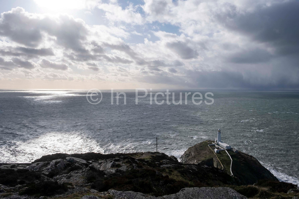 The South Stack Lighthouse, a fog warning lighthouse on an island off the coast of Holyhead Breakwater Country Park on the coast of Holyhead, on 20th February 2020 in Anglesey, North Wales, United Kingdom. The country park opened in 1990 and is on the site of an old stone quarry.