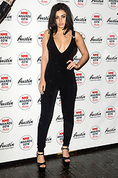 © Licensed to London News Pictures. 17/02/2016. CHARLI XCX arrives at the NME Awards 2016 with Austin, Texas.  Previous winners of NME's Godlike Genius Award include Suede, Blondie, The Clash, Paul Weller, The Cure, Manic Street Preachers, New Order & Joy Division, Dave Grohl, Noel Gallagher and Johnny Marr.  London, UK. Photo credit: Ray Tang/LNP