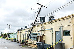 October 7, 2016 - Florida, U.S. - A power pole leans against the back of a building on Park Avenue in Lake Park Friday morning, October 7, 2016  after the passing of Hurricane Matthew. (Credit Image: © Lannis Waters/The Palm Beach Post via ZUMA Wire)