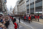 The coffin of baroness thatcher passes along Fleet Street on route to St. Paul's cathedral where her funeral took place. 17th April 2013. London, United Kingdom.