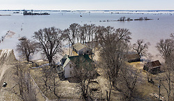 March 21, 2019 - Craig, Missouri, U.S. - Flood waters surrounded a house near Craig, Mo., in Holt County on Thursday,  after the a levee breached on Wednesday. The Missouri River continued to rise to near record levels inundating more land with water. (Credit Image: © Tammy Ljungblad/Kansas City Star/TNS via ZUMA Wire)