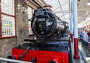 Old steam engine McArthur Glen designer outlet former railway works, Swindon, Wiltshire, England, UK - West Somerset Railway train 7821 Ditcheat Manor