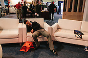 An attendee takes a nap on a lounge chair in the HUB during day two of the Conservative Political Action Conference (CPAC) at the Gaylord National Resort & Convention Center in National Harbor, Md.