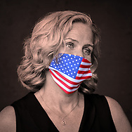 East Meadow, New York, U.S. September 10, 2020. Nassau County Executive LAURA CURRAN wears a face mask with American flag design, during the COVID-19 pandemic, at the county Remembrance Ceremony at Eisenhower Park commemorating 19th anniversary of September 11, 2001 terrorist attacks. The names of the 348 county residents killed were read on stage.