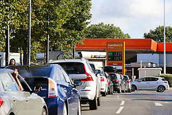 © Licensed to London News Pictures. 04/10/2021. London, UK. Motorists queue for the eleventh day at Sainsbury's petrol station in north London as the fuel crisis continues. <br /> The army begins delivering fuel to stations to help tackle the fuel crisis, caused by a shortage of heavy goods vehicle drivers and panic buying. The troops will concentrate on deliveries in London and the South East of England where the worst of the fuel shortage remains. Photo credit: Dinendra Haria/LNP