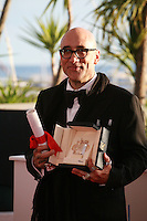 Bruce Wagner (for Julianne Moore) with the prize for Best Performance by an Actress for the film Maps to the Stars at the Palme d'Or winners photo call at the 67th Cannes Film Festival, Saturday 24th May 2014, Cannes, France.