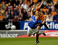 Photo: Richard Lane.<br /> Wolves v Leicester City. Coca Cola Championship.<br /> 17/09/2005.<br /> Leicester's Joey Gudjonsson is knocked to the floor by Wolves' Rob Edwards.