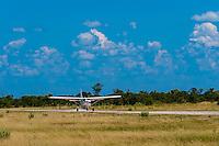 Airplane landing at Kwando Concession, Linyanti Marshes, Botswana.