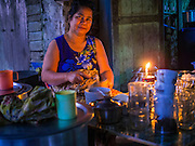08 NOVEMBER 2014 - SITTWE, RAKHINE, MYANMAR:  A women in her tea shop early in the morning in Sittwe. Sittwe is a small town in the Myanmar state of Rakhine, on the Bay of Bengal.  PHOTO BY JACK KURTZ