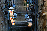 Street lights advertising ice-cream, steeply stepped street, Dubrovnik old town, Croatia