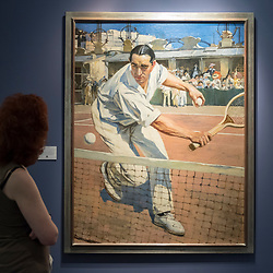"""© Licensed to London News Pictures. 28/06/2018. LONDON, UK. A visitor views """"The French tennis champion, Max Decugis"""", 1904, by François Flameng. Members of the public visit Masterpiece London, the world's leading cross-collecting art fair held in the grounds of the Royal Hospital Chelsea.  The fair brings together 160 international exhibitors presenting works from antiquity to the present day and runs 28 June to 4 July 2018.  Photo credit: Stephen Chung/LNP"""