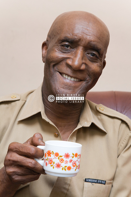 Older man sitting at home enjoying a cup of coffee,