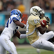 Central Florida wide receiver Joshua Reese (80) makes a catch against Memphis defensive back Taurean Nixon (30) during an NCAA football game between the Memphis Tigers and the Central Florida Knights at Bright House Networks Stadium on Saturday, October 29, 2011 in Orlando, Florida. (AP Photo/Alex Menendez)