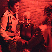 Evangelists comfort a transexual at a prostitution zone in Rotterdam...Victory Outreach, a controversial church started in Los Angeles in 1967, is spreading to Europe via the Netherlands. It builds its membership among junkies, prostitutes and criminals. ..Photo taken in the Netherlands in 2002. The picture is part of a photo and text documentary by Justin Jin. For more information, email justin@justinjin.com