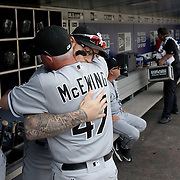 NEW YORK, NEW YORK - June 01: Coach Joe McEwing #47 of the Chicago White Sox and Brett Lawrie #15 of the Chicago White Sox embrace in the dugout before the Chicago White Sox  Vs New York Mets regular season MLB game at Citi Field on June 01, 2016 in New York City. (Photo by Tim Clayton/Corbis via Getty Images)