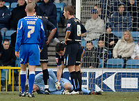 Photo: Daniel Hambury.<br />Millwall v Sheffield Wednesday. Coca Cola Championship. 04/02/2006.<br />Sheffield's David Lucas lies injured. He was replaced late in the first half.