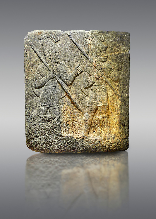Hittite relief sculpted orthostat stone panel of Herald's Wall. Limestone, Karkamıs, (Kargamıs), Carchemish (Karkemish), 900-700 B.C. Military parade. Anatolian Civilisations Museum, Ankara, Turkey.<br /> <br /> Three helmeted soldiers in short skirts carry the shield on their backs and the spears in their hands. The bottom right part of the relief was left untreated since the pedestal stood in front of it. .<br />  <br /> If you prefer to buy from our ALAMY STOCK LIBRARY page at https://www.alamy.com/portfolio/paul-williams-funkystock/hittite-art-antiquities.html  - Type  Karkamıs in LOWER SEARCH WITHIN GALLERY box. Refine search by adding background colour, place, museum etc.<br /> <br /> Visit our HITTITE PHOTO COLLECTIONS for more photos to download or buy as wall art prints https://funkystock.photoshelter.com/gallery-collection/The-Hittites-Art-Artefacts-Antiquities-Historic-Sites-Pictures-Images-of/C0000NUBSMhSc3Oo