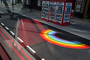 With a further 184 reported UK Covid deaths in the last 24 hrs, a total now of 43,414, seen from a London bus is an NHS supporting rainbow is at a Victoria Station bus stop, a part of the social distance policy of widening pavements for pedestrians, on 26th June 2020, in London, England. Government restrictions on the 2 metre rule is to be relaxed on 4th July and replaced with 'one metre plus' in the hope it stimulates the struggling UK economy.