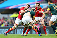 Dan Lydiate of Wales tackles Schalk Burger of South Africa.Rugby World Cup 2015 quarter final match, South Africa v Wales at Twickenham Stadium in London, England  on Saturday 17th October 2015.<br /> pic by  John Patrick Fletcher, Andrew Orchard sports photography.
