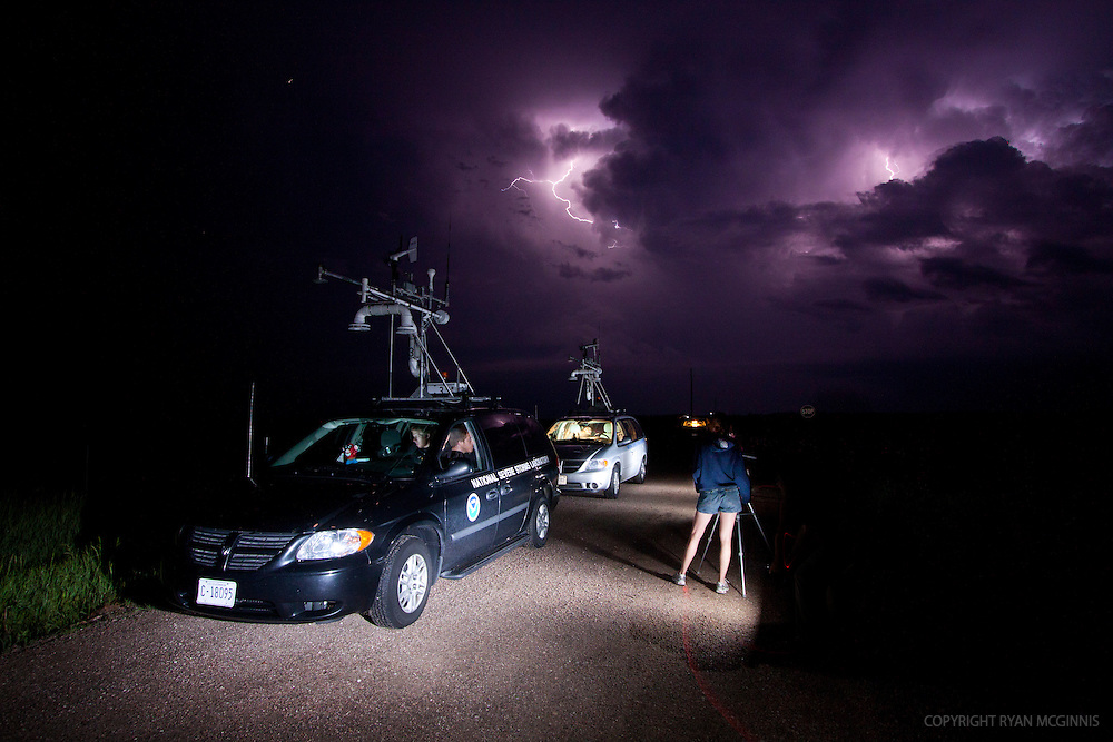 National Severe Storms Labratory probe vehicles parked alongside the road in the rural sandhills of Nebraska, as Vortex participants monitor lightning in the distance, June 9, 2010.