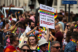 "© Licensed to London News Pictures . 05/08/2018. Leeds, UK. "" The only phase I went through was being straight "" placard . Leeds Gay Pride parade through the Yorkshire city's centre . Leeds's annual Gay Pride festiva celebrates the city's LGBTQ+ life and culture . Photo credit: Joel Goodman/LNP"