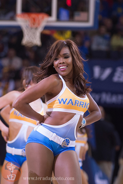 November 17, 2015; Oakland, CA, USA; Golden State Warriors Dance Team dancer Jasmine performs during the second quarter against the Toronto Raptors at Oracle Arena. The Warriors defeated the Raptors 115-110.