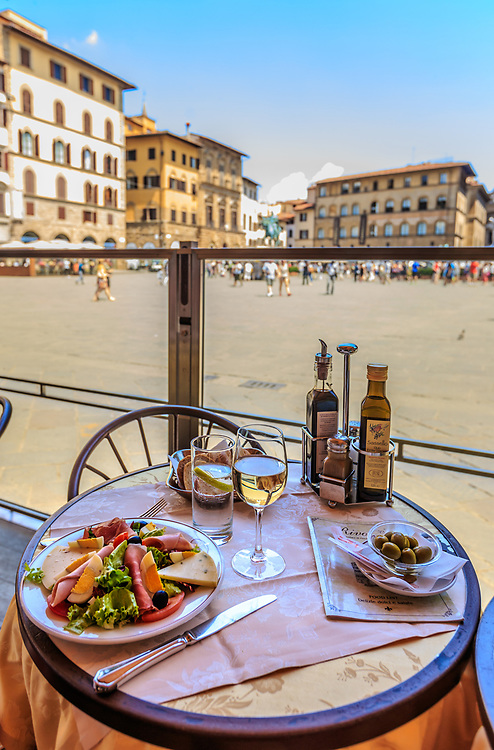 Salad at Piazza della Signoria in Florence, Italy. Piazza Della Signoria has always been the center of political life in the city. This piazza tells glorious stories of Florence through its fascinating architecture and its exceptional works of art.