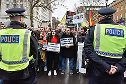 © Licensed to London News Pictures. 27/01/2018. LONDON, UK.  Police stand in front of Downing Street as thousands of Kurdish people march from outside the BBC's Headquarters in Portland Place to Downing Street to protest against Turkey's military invasion of the city of Afrin in Northern Syria, a predominantly Kurdish city.  Protesters called for the British public to show solidarity with the people of Afrin and for the UK to demand that Turkey pull back its forces.  Photo credit: Stephen Chung/LNP