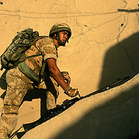 8th July 2007.Kajaki, helmand Province, Afghanistan.Soldiers of 1 Royal Anglian C Coy move through a series of compounds at first light searching them in order to flush out Taliban fighters who have been using the locations as firing positions. The enemy were spotted and a sporadic firefight ensued. Kajaki, Helmand Province, Afghanistan, 8th July 2007.