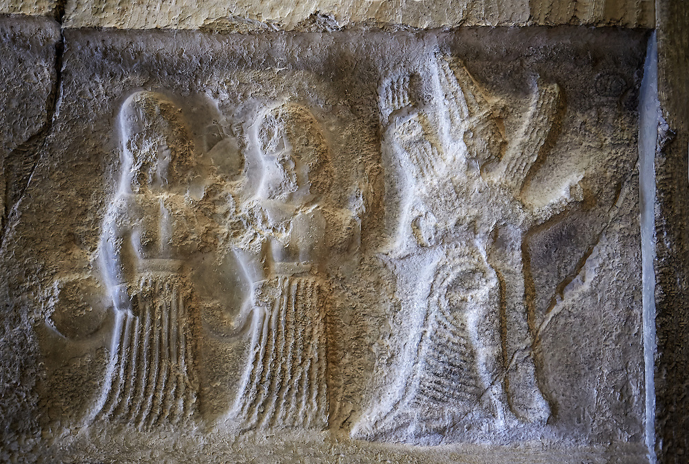 Hittite relief sculptures of Gods at the Yazilikaya Sancutary [ i.e written riock ], Hattusa, Turkey.  The largest known Hittite sanctuary. 12th - 13th century BC made in the reign of Tudhaliya 1V . Plastercast at the Vorderasiatisches Museum, Pergamon Museum, Berlin. .<br /> <br /> If you prefer to buy from our ALAMY PHOTO LIBRARY  Collection visit : https://www.alamy.com/portfolio/paul-williams-funkystock/yazilikaya-hittite-sanctuary-hattusa.html<br /> <br /> Visit our ANCIENT WORLD PHOTO COLLECTIONS for more photos to download or buy as wall art prints https://funkystock.photoshelter.com/gallery-collection/Ancient-World-Art-Antiquities-Historic-Sites-Pictures-Images-of/C00006u26yqSkDOM