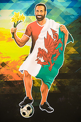 EMBARGOED TO 0001 FRIDAY JUNE 4 EDITORIAL USE ONLY GV of a painting to Rio Ferdinand, depicting the former England footballer draped in a Welsh flag as part of a 'Hall of Fame' set up by Robbie and UEFA EURO 2020 Official Partner Heineken, ahead of this summer's tournament. Issue date: Friday June 4, 2021.