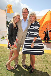 POPPY DELEVINGNE and her parents CHARLES & PANDORA DELEVINGNE at the 2009 Veuve Clicquot Gold Cup Polo final at Cowdray Park Polo Club, Midhurst, West Sussex on 19th July 2009.
