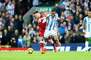 Alberto Moreno of Liverpool (l) and Rajiv van La Parra of Huddersfield Town battle for the ball. Premier League match, Liverpool v Huddersfield Town at the Anfield stadium in Liverpool, Merseyside on Saturday 28th October 2017.<br /> pic by Chris Stading, Andrew Orchard sports photography.