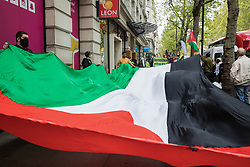Activists from Palestine Action protest with a huge Palestinian flag outside the UK headquarters of Elbit Systems, an Israel-based company developing technologies used for military applications including drones, precision guidance, surveillance and intruder-detection systems, on 11th May 2021 in London, United Kingdom. The activists were protesting against the company's presence in the UK and in solidarity with the Palestinian people following attempts at forced evictions of Palestinian families in the Sheikh Jarrah neighbourhood of East Jerusalem, the deployment of Israeli forces against worshippers at the Al-Aqsa mosque during Ramadan and air strikes on Gaza which have killed several children.