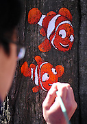 DALIAN, CHINA - (CHINA OUT) <br /> <br /> College Girl Creates Tree Paintings In China<br /> Photo shows a tree hollow painting in Dalian, Liaoning Province of China. Wang Yue, a senior student at the Dalian Polytechnic University, and 11 volunteers used their paintbrushes to turn ugly tree holes into lovely views in Dalian. <br /> ©ChinaFoto/Exclusivepix
