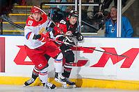 KELOWNA, CANADA - NOVEMBER 9: Radel Fazleev #19 of Team Russia checks Ryan Gropp #12 of Team WHL into the boards on November 9, 2015 during game 1 of the Canada Russia Super Series at Prospera Place in Kelowna, British Columbia, Canada.  (Photo by Marissa Baecker/Western Hockey League)  *** Local Caption *** Radel Fazleev; Ryan Gropp;