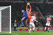 Stoke City Goalkeeper Lee Grant catches the ball under pressure from Islam Slimani of Leicester City. Premier league match, Stoke City v Leicester City at the Bet365 Stadium in Stoke on Trent, Staffs on Saturday 17th December 2016.<br /> pic by Chris Stading, Andrew Orchard sports photography.