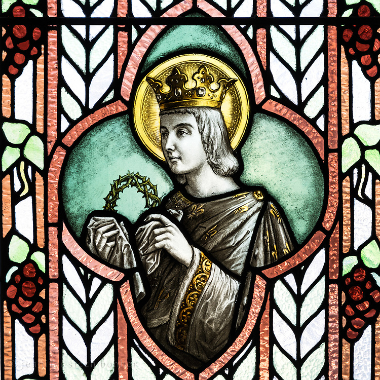 Saint Louis was the patron saint of Louise Drexel Morrell, who financed the convent's construction. I have very mixed feelings about him. King of France from 1226-1270, he was 12 years old when he was crowned. He introduced the idea of presumption of innocence to the French judicial system and banned trials by ordeal - but he also expanded the Inquisition and introduced gruesome punishments for blasphemy. He was a patron of art and architecture, and commissioned some of the masterpieces of High Gothic style - but he also burned thousands of Jewish manuscripts. He's usually shown holding the Crown of Thorns because he bought it from the Emperor of Constantinople and built the stunningly gorgeous Sainte Chapelle in Paris as a shrine to house it.<br /> <br /> As with St. Edward on the other side of the bay window, I wonder if the Morrells chose St. Louis for his role as architectural patron.