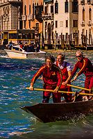 A rowing team practicing along the Grand Canal, Venice, Italy.