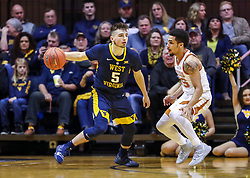 Feb 9, 2019; Morgantown, WV, USA; West Virginia Mountaineers guard Jordan McCabe (5) dribbles during the first half against the Texas Longhorns at WVU Coliseum. Mandatory Credit: Ben Queen-USA TODAY Sports